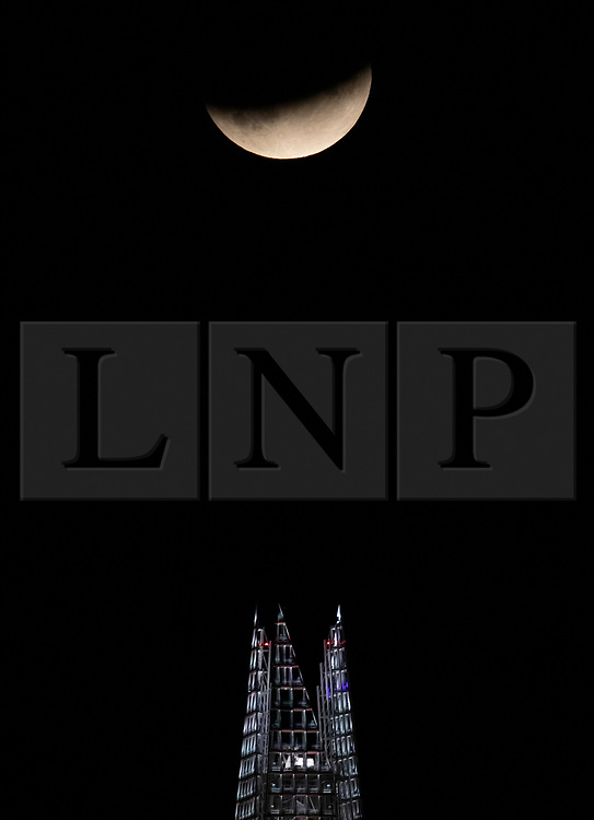 © Licensed to London News Pictures. 16/07/2019. London, UK. July's full moon, known as the 'Buck Moon', rises over  the Shard in central London during a partial lunar eclipse. The eclipse occurs on the 50th anniversary of the launch of NASA's Apollo 11 mission to place men on the moon's surface in July 1969. Photo credit: Peter Macdiarmid/LNP
