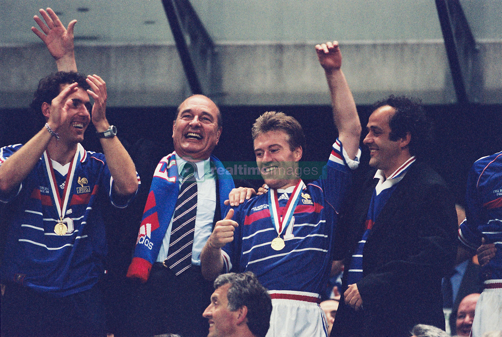 President Jacques Chirac, flanked by France's teammates Laurent Blanc and Didier Deschamps and Michel Platini, celebrates after the FIFA football world cup France v Brazil final match at the Stade de France stadium in Saint-Denis, near Paris, France, July 12, 1998. France won 3-0. Photo by Lionel Hahn/ABACAPRESS.COM