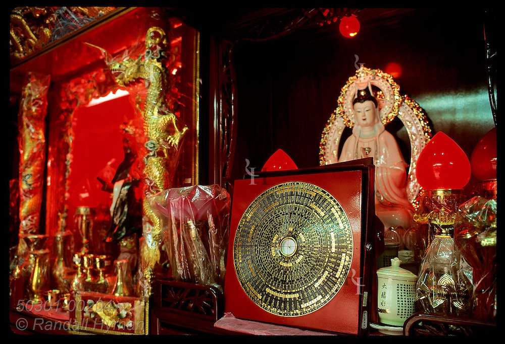 Lo P'an compass, used in Feng Shui, sits amid Buddhist items in religious shop; Kowloon. Hong Kong