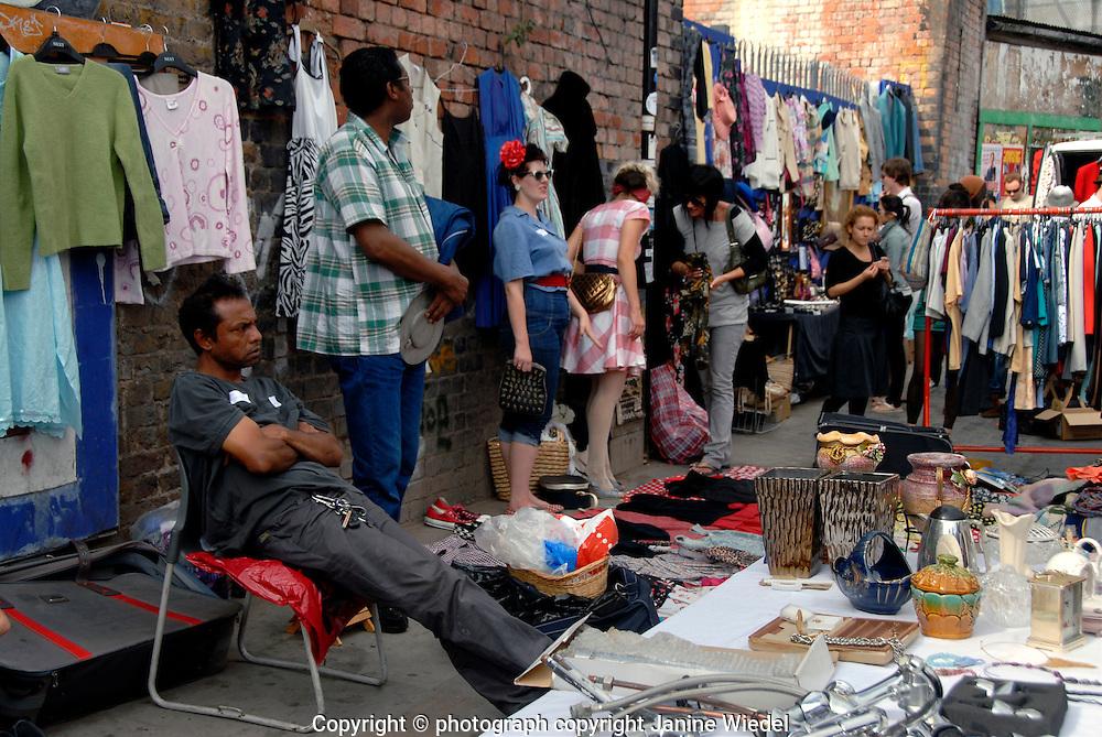 Brick Lane flea market on Sunday in east end.