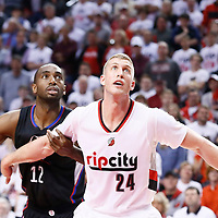 25 April 2016: Portland Trail Blazers center Mason Plumlee (24) vies for the rebound with Los Angeles Clippers forward Luc Richard Mbah a Moute (12) during the Portland Trail Blazers 98-84 victory over the Los Angeles Clippers, during Game Four of the Western Conference Quarterfinals of the NBA Playoffs at the Moda Center, Portland, Oregon, USA.