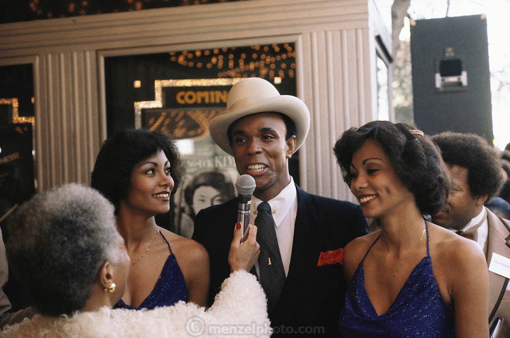 Black film makers film festival at the downtown Paramount art deco theater in Oakland, California. Ralph Wilcox with twins Ramona and Renee Rolle.