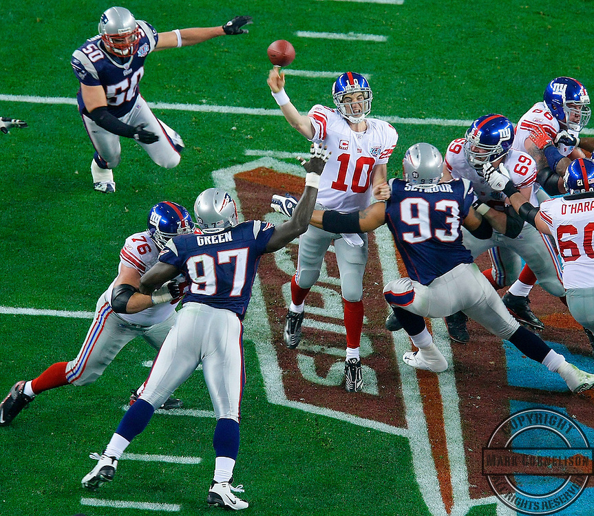 The New England Patriots pressure the New York Giants' Eli Manning in the first quarter of Super Bowl XLII at University of Phoenix Stadium in Glendale, Arizona, on Sunday, February 3, 2008. (Mark Cornelison/MCT)