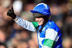 Jockey Lizzie Kelly on board Coo Star Sivola celebrates winning the Ultima Handicap Chase during Champion Day of the 2018 Cheltenham Festival at Cheltenham Racecourse