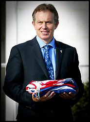 The British Prime Minister Tony Blair hOlds The Union Jack in his hands today Saturday May 1st 2004 in Dublin,Ireland,on the day of the EU Enlargement at Farmleigh House.PA PHoto Andrew Parsons