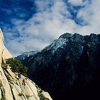 Rock climber climbing the classic off-width crack, 5.10d, Little Cottonwood Canyon, Utah