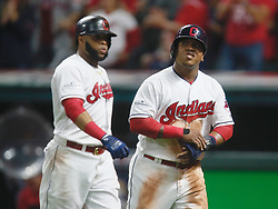 October 5, 2017 - Cleveland, OH, UKR - The Cleveland Indians' Jose Ramirez, right, scores on a sacrifice fly by Jay Bruce in the fifth inning against the New York Yankees in Game 1 of the American League Division Series on Thursday, Oct. 5, 2017, at Progressive Field in Cleveland. At left is Indians first baseman Carlos Santana. (Credit Image: © Leah Klafczynski/TNS via ZUMA Wire)