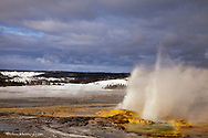 Clepsydra geyser erupts in the Lower Geyser Basin in Yellowstone National Park, Wyoming, USA