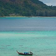 Longtail boat and kayak on Ko Lipe beach, Thailand