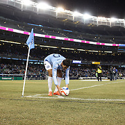 Mehdi Ballouchy, NYCFC, prepares to take a corner  during the New York City FC Vs Sporting Kansas City, MSL regular season football match at Yankee Stadium, The Bronx, New York,  USA. 27th March 2015. Photo Tim Clayton