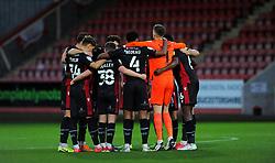 Scunthorpe United players huddle together before kick-off- Mandatory by-line: Nizaam Jones/JMP - 20/10/2020 - FOOTBALL - Jonny-Rocks Stadium - Cheltenham, England - Cheltenham Town v Scunthorpe United - Sky Bet League Two