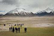People leaving. Attending the funeral of Haji Osman Boi (one of the Rais-e Shura, a chief Council) in Andemin camp. ..Trekking through the high altitude plateau of the Little Pamir mountains (average 4200 meters) , where the Afghan Kyrgyz community live all year, on the borders of China, Tajikistan and Pakistan.