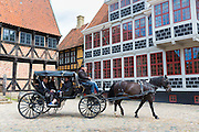 Horse and carriage by Mayor's House at Den Gamle By, The Old Town, open-air folk museum at Aarhus,  East Jutland, Denmark