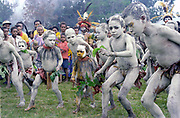 Boys dressed as Asaro mudmen perform at a school cultural show, Asaroka High School, Highlands Province, Papua New Guinea 1985