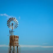 Windmill standing in an empty farm field in outback Australia.