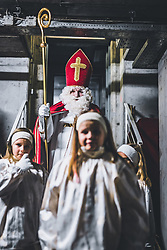 THEMENBILD - Nikolaus mit Engel, während eines traditionellen Hausbesuchs der Nikoaus und Krampusgruppe Frieden, aufgenommen am 04. Dezember 2018 in Lienz, Österreich // Home visit from Krampus and Saint Nicholas. Krampus a mythical creature that, according to legend, accompanies Saint Nicholas during the festive season. Instead of giving gifts to good children, he punishes the bad ones, Lienz, Austria on 2018/12/04. EXPA Pictures © 2018, PhotoCredit: EXPA/ JFK