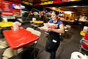 """Michele Rodriguez serving the famous Sonora Mexico style hot dogs at """"El Caprichoso"""" in downtown Phoenix on August 19, 2016."""
