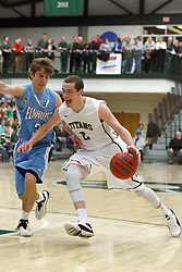 21 February 2015:  Dylan Overstreet guarded by Eric Leonard during an NCAA men's division 3 CCIW basketball game between the Elmhurst Bluejays and the Illinois Wesleyan Titans in Shirk Center, Bloomington IL