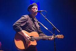 Richard Thompson singing and playing a guitar on stage at the Cropredy Festival  Fairport's Cropredy Convention  2005