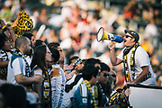 A man leads the Angel City Brigade in a chant during the first half of an MLS soccer match between the Los Angeles Galaxy and Seattle Sounders FC, Monday, July 4, 2011, in Carson, Calif. (AP Photo/Bret Hartman)7
