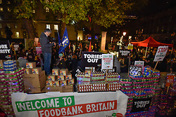 © Licensed to London News Pictures. 21/11/2017. London, UK. People gather outside Downing Street, for an Anti-Tory protest, organised by the People's Assembly, on the eve of Chancellor Philip Hammond presenting the Budget. A food collection will be donated to local foodbanks following the fallout from Universal Credit and the continuation of austerity policies in the Budget Photo credit: Stephen Chung/LNP