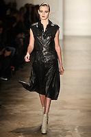 Kori Richardson walks the runway wearing Altuzarra Fall 2011 Collection during Mercedes-Benz Fashion Week in New York on February 12, 2011