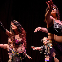 051515       Cable Hoover<br /> <br /> Leaf Ashley, left, leads the belly dancing troupe during the Foundations of Freedom annual recital at El Morro Theatre Friday.