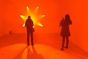 """© Licensed to London News Pictures. 29/01/2013. London, UK People look at Ann Veronica Janssens' work, """"Rose (2007). Press preview of """"Light Show"""" at the Hayward Gallery at the Southbank Centre in London today 29th January 2013. The exhibition runs 30th Jan-28th Apr 2013. Photo credit : Stephen Simpson/LNP"""