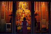 Woman praying Buddha  in the Jing'an Temple , Shanghai, China