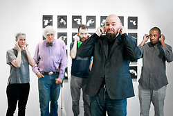 02 October 2014. Jonathan Ferrara Gallery, New Orleans, Louisiana. <br /> Jonathan Ferrara Gallery. 'Guns In The Hands Of Artists' opening. L/R; Artists Sidone Villere, Robert C Tannen, Skylar Fein, Jonathan Ferrara and John Barnes plug their fingers for a gun test fire. The show brings together over 30 internationally acclaimed artists who took parts from 190 destroyed weapons acquired by the New Orleans Police department  and converted them into art.  <br /> Photo; Charlie Varley/varleypix.com