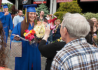 Emilee Laroche is showered with flowers and well wishes as she finds her grandpa Lee Laroche in the crowd following Gilford High School graduation at Bank of NH Pavilion at Meadowbrook Saturday morning.  (Karen Bobotas/for the Laconia Daily Sun)