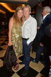 AMBER NUTTALL and ALISTAIR GOSLING at the London launch of Casamigos Tequila hosted by Rande Gerber, George Clooney & Michael Meldman and to celebrate Cindy Crawford's new book 'Becoming' held at The Beaumont Hotel, Brown Hart Gardens, 8 Balderton Street, London on 1st October 2015.