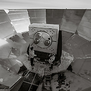 Inside the grond shield of the Keck Array Telescope with 2 of the recievers removed as part of the upgrade of the telescope to the BICEP Array Telescope.