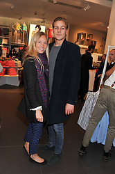 MARTHA WARD and TOBY KNOTT at the Launch Of The Marni For H&M Collection held at H&M Regent Street, London on 7th March 2012.