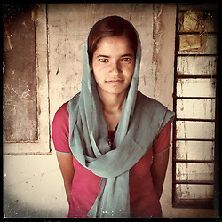 """iPhone portrait of Keshanta Gujar, 16, in a village outside of Tonk, Rajasthan, India, April 3, 2013. """"To my colleagues and other girls I want to say that you too must study. I think that even kids can say no to their parents for marriage,"""" said Gujar. <br />  <br /> Under Indian law, children younger than 18 cannot marry. Yet in a number of India's states, at least half of all girls are married before they turn 18, according to statistics gathered in 2012 by the United Nations Population Fund (UNFPA). However, young girls in the Indian state of Rajasthan—and even a few boys—are getting some help in combatting child marriage. In villages throughout Tonk, Jaipur and Banswara districts, the Center for Unfolding Learning Potential, or CULP, uses its Pehchan Project to reach out to girls, generally between the ages of 9 and 14, who either left school early or never went at all. The education and confidence-building CULP offers have empowered youngsters to refuse forced marriages in favor of continuing their studies, and the nongovernmental organization has provided them with resources and advocates in their fight."""