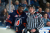 KELOWNA, CANADA - FEBRUARY 24: Jermaine Loewen #32 of the Kamloops Blazers speaks to linesman Tim Plamondon on the ice against the Kelowna Rockets  on February 24, 2018 at Prospera Place in Kelowna, British Columbia, Canada.  (Photo by Marissa Baecker/Shoot the Breeze)  *** Local Caption ***