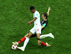 July 11, 2018 - Moscow, Russia - July 11, 2018, Moscow, FIFA World Cup 2018 Football, the playoff round. 1/2 finals of the World Cup. Football match Croatia - England at the stadium Luzhniki. Player of the national team Markus Rashford (19), Luka Modric  (Credit Image: © Russian Look via ZUMA Wire)