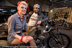 Loris Giavelli with a model posing on his Knucklehead at Motor Bike Expo. Verona, Italy. Friday January 20, 2017. Photography ©2017 Michael Lichter.