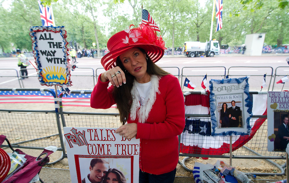 Royal enthusiasts Boepple from Huston, Texas poses with a replica of the Kate Middleton's engagment ring, at the junction of the Mall and Horse Guards Road for the Royal Wedding in London Friday, April, 29, 2011. (AP Photo/Bogdan Maran)