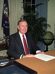United States President George H.W. Bush poses for photographers after delivering an address to the nation from the Oval Office of the White House in Washington, DC on Christmas Day, December 25, 1991 announcing the resignation of President Mikhail Gorbachev as President of the Union of Soviet Socialist Republics, marking the collapse of the Soviet Union and the end of the Cold War. Photo by Arnie Sachs / CNP /ABACAPRESSC.OM
