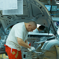 Workers assemble a car belonging to the Audi TT family in the Audi factory in Gyor (about 120 km West of Budapest), Hungary on November 05, 2014. ATTILA VOLGYI