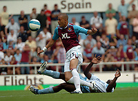 Photo: Tony Oudot. <br /> West Ham United v Manchester City. Barclays Premiership. 11/08/2007. <br /> Bobby Zamora of West Ham is challenged by Micah Richards of Manchester City