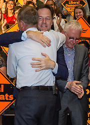 © Licensed to London News Pictures. 16/07/2015. London, UK. Norman Lamb looks dejected as Nick Clegg greets Tim Farron at Islington Assembly Hall for Farron's first rally as Leader of the Liberal Democrats after beating Norman Lamb in the contest to succeed Nick Clegg. Photo credit : James Gourley/LNP