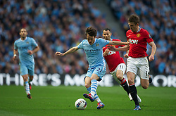 MANCHESTER, ENGLAND - Monday, April 30, 2012: Manchester City's David Silva in action against Manchester United's Michael Carrick during the Premiership match at the City of Manchester Stadium. (Pic by Chris Brunskill/Propaganda)