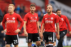 Sheffield United's Ched Evans (second left) warming up before the Carabao Cup, Second Round match at Bramall Lane, Sheffield.