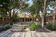 A shady courtyard for outdoor entertainments at the City Palace in Udaipur, Rajasthan, India <br /> <br /> Editorial & Non-Commercial use only