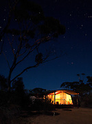 Tent at sunset at an eco campsite in the Gawler Ranges National Park, South Australia, Australia