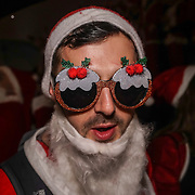 Hundreds of Santas decend on Trafalgar Square at the end of the annual SantaCon on 10th December 2016,London,UK. Photo by See Li