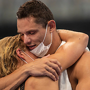 TOKYO, JAPAN - AUGUST 1:  Florent Manaudou of France, who won silver in the 50m freestyle for Men, embraces partner Pernille Blume of Denmark who won bronze in the 50m freestyle for women during the Swimming Finals nat the Tokyo Aquatic Centre at the Tokyo 2020 Summer Olympic Games on August 1, 2021 in Tokyo, Japan. (Photo by Tim Clayton/Corbis via Getty Images)