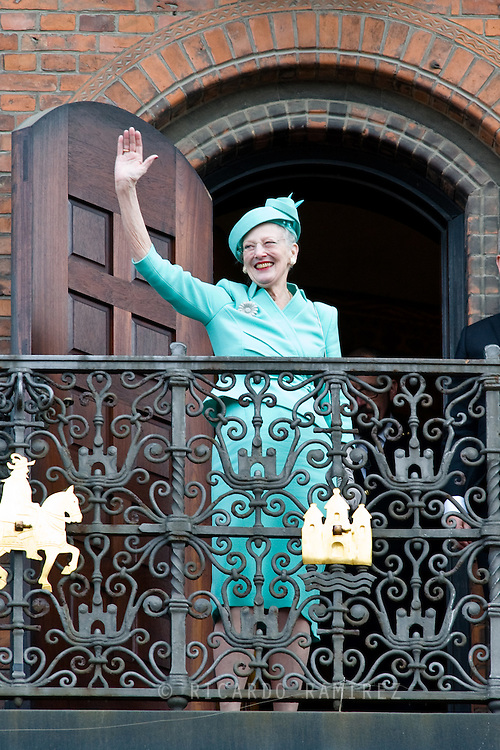 16.04.2015. Copenhagen, Denmark.<br /> Queen Margrethe II of Denmark waves from the Town Hall balcony after lunch during festivities for her 75th birthday.<br /> Photo:© Ricardo Ramirez